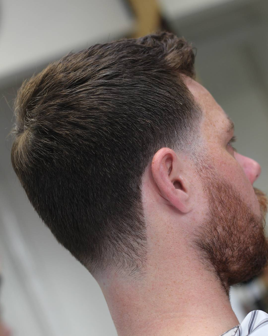 Short haircut with low taper fade