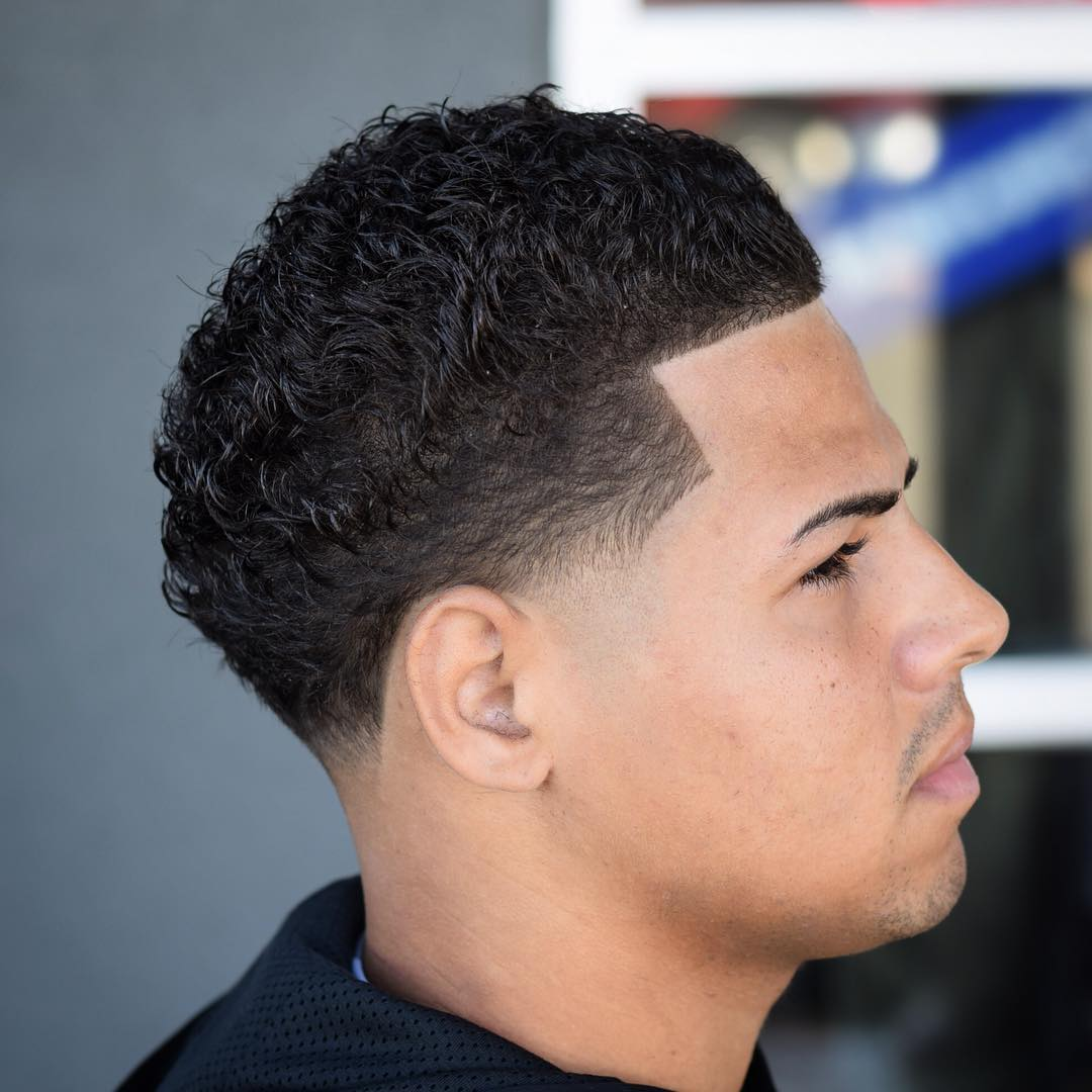 Cool mens taper fade haircut for curly hair