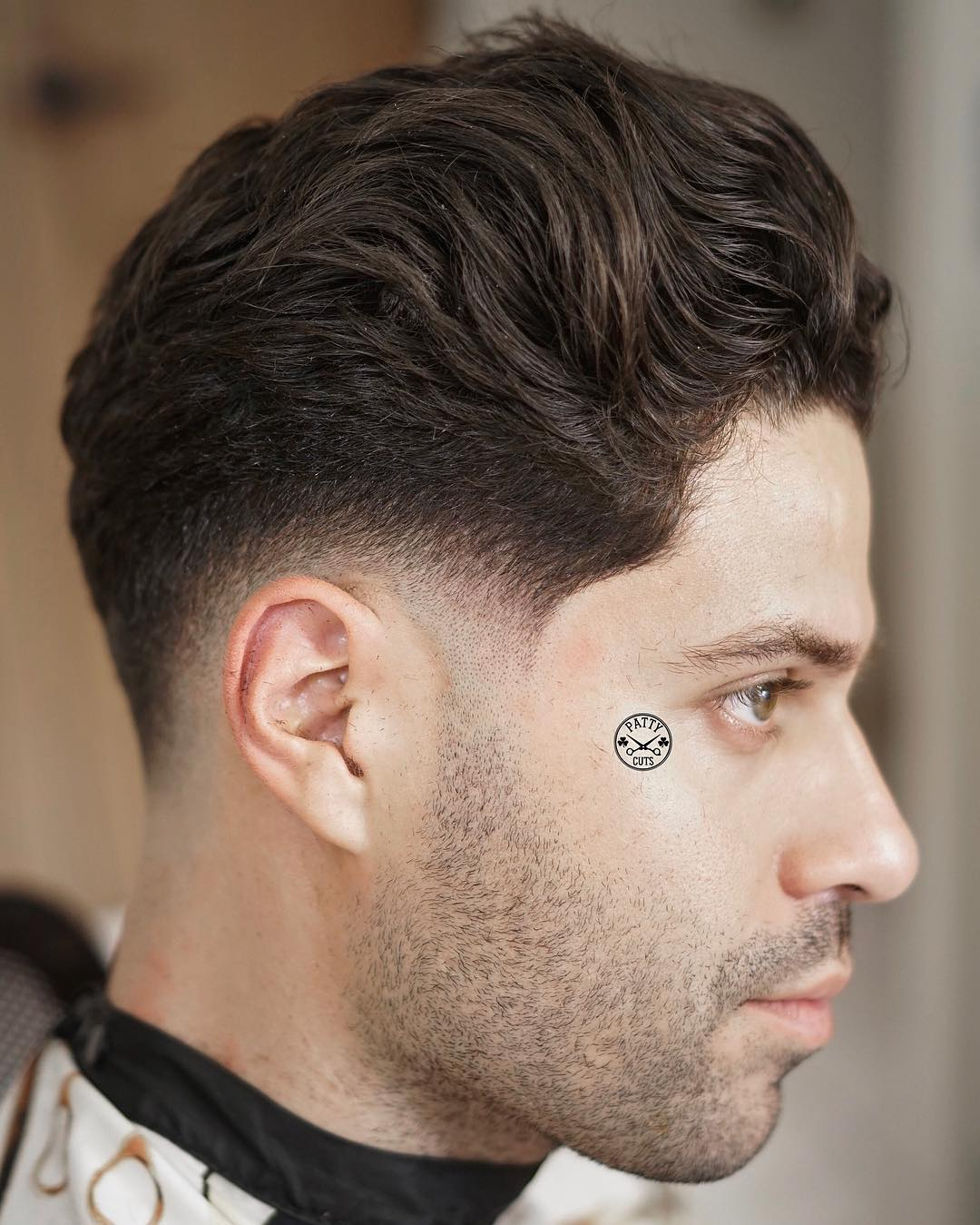 Low fade haircut and medium mens hairstyle