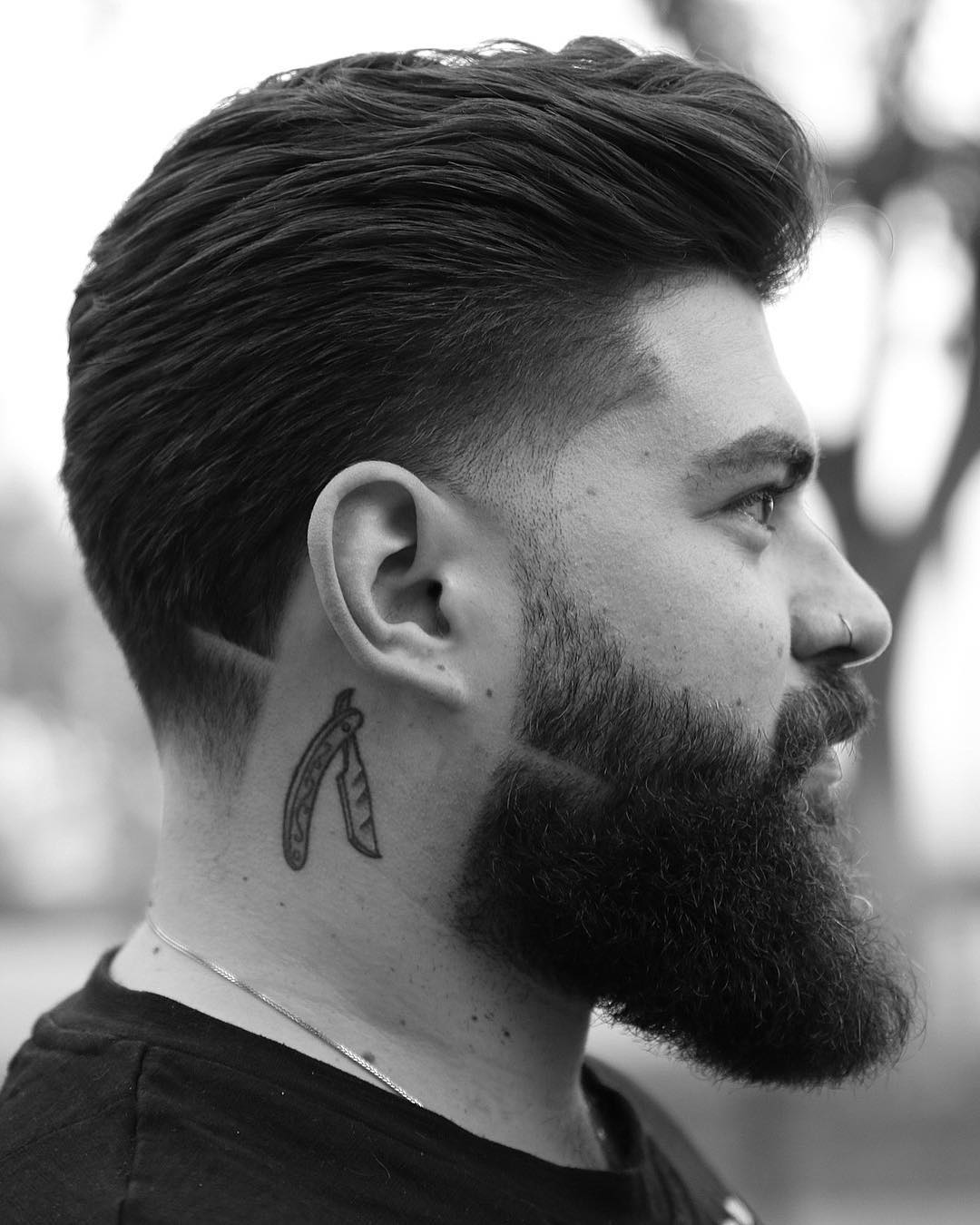Slicked back hair taper fade haircut for men medium length hair