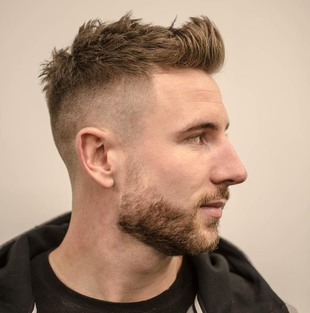Cool short quiff haircut for men with a high bald fade