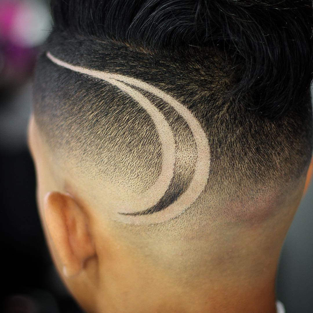 Fade haircut with cool hair design