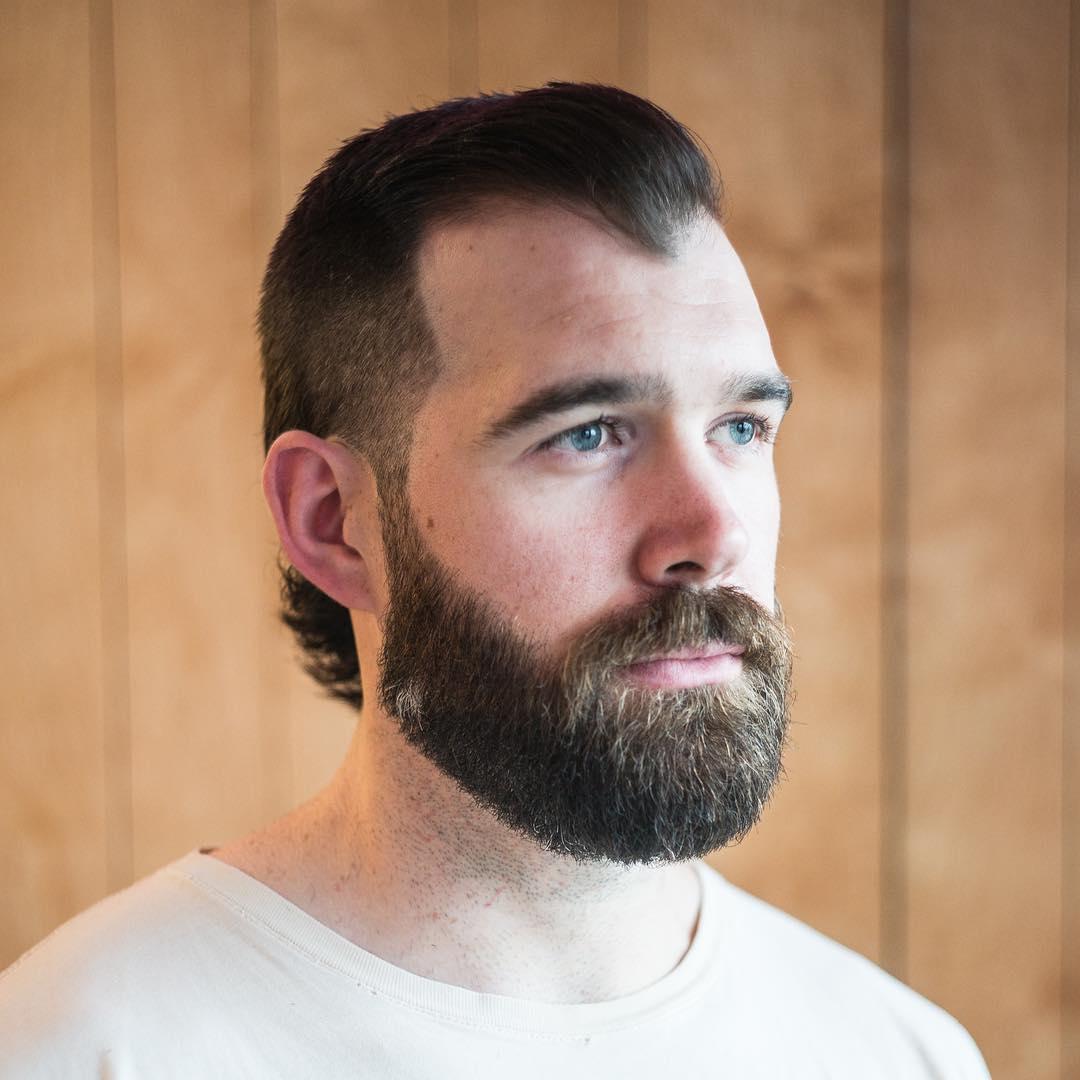 Short mullet haircut and beard