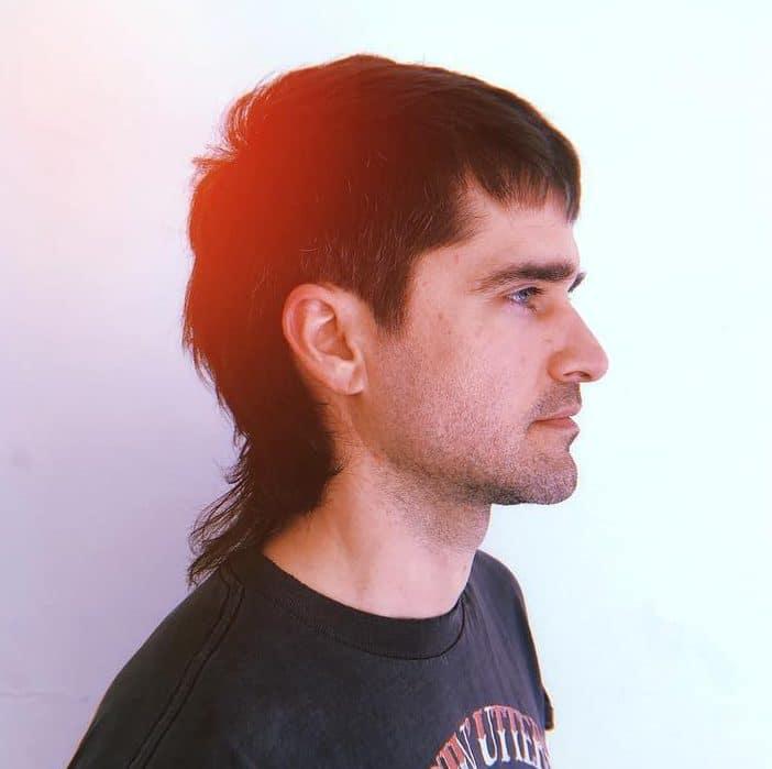 Long hair men mullet haircut