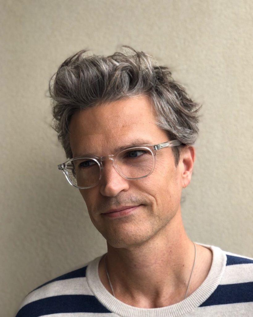 modern haircuts for wavy hair men