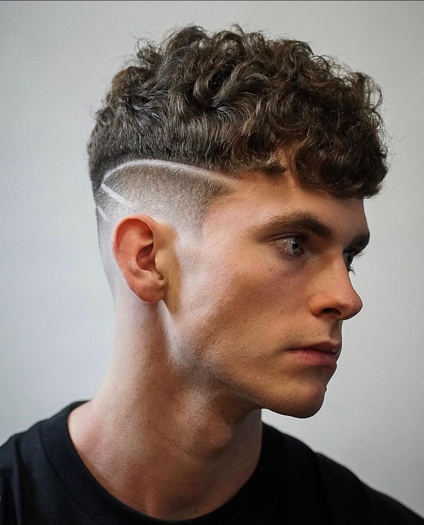 Curly drop fade haircut with hair design