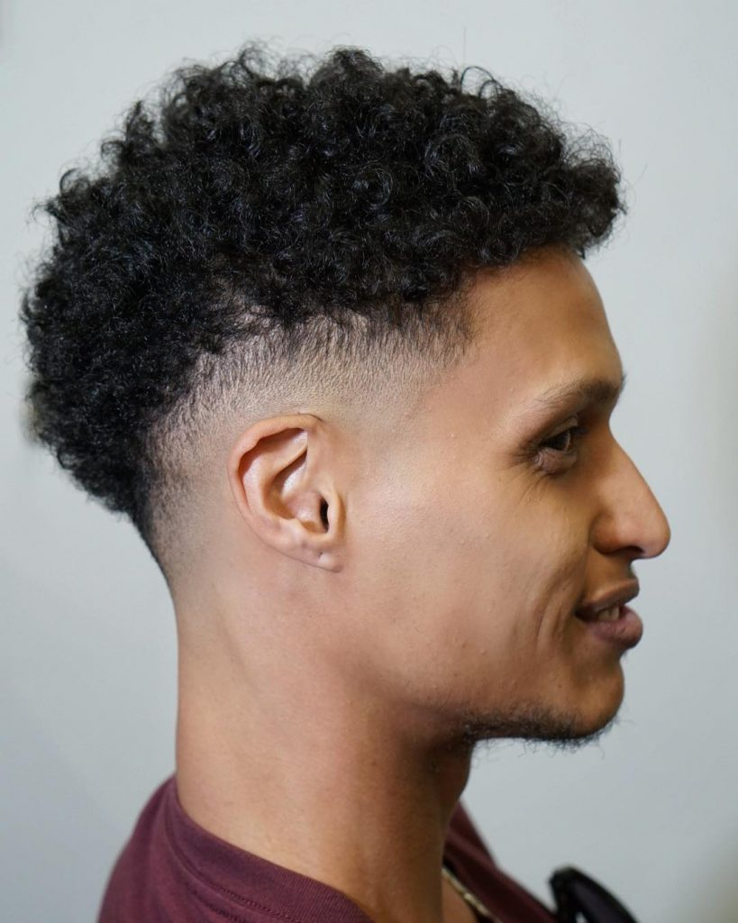 Thick curly hair with a drop fade