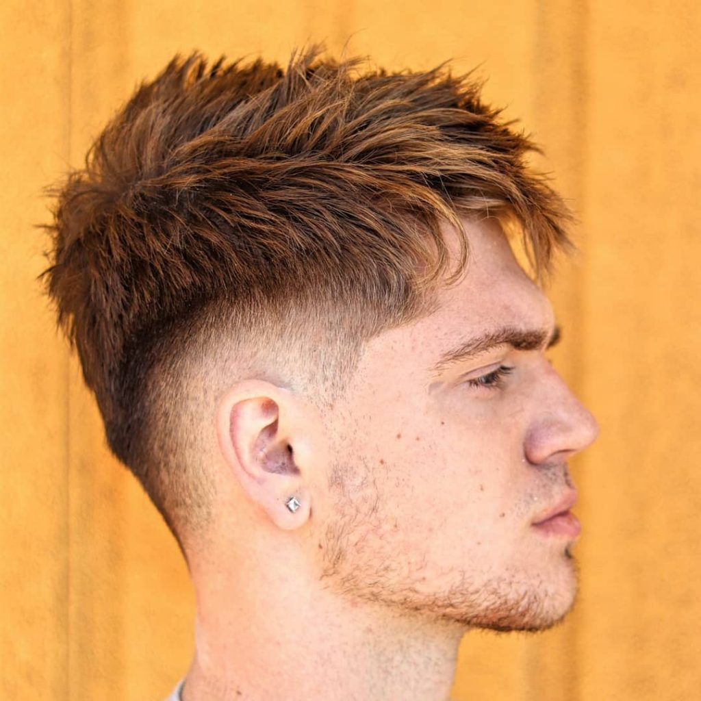 Textured fade hairstyle with a drop fade