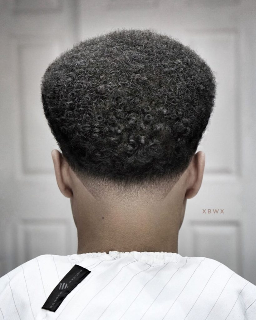 Taper fade with an afro