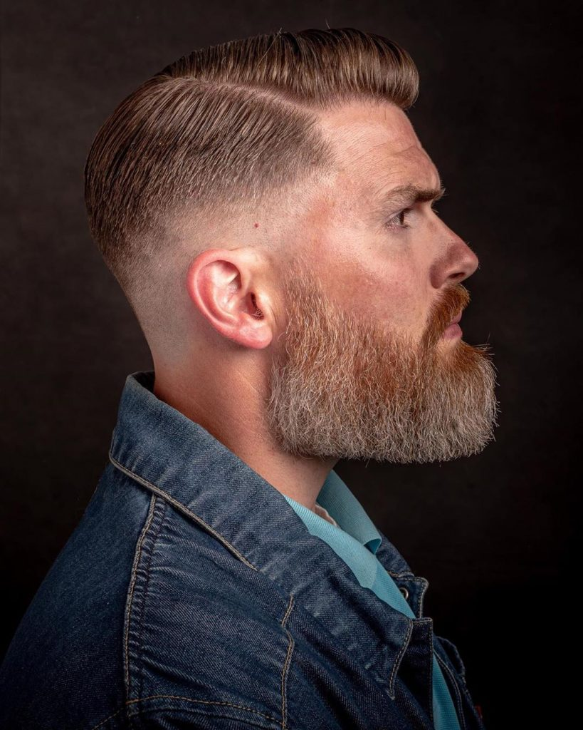 Low skin fade side part haircut
