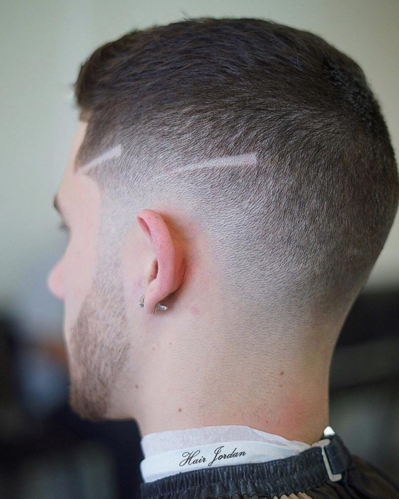 Short high fade haircut with hair design