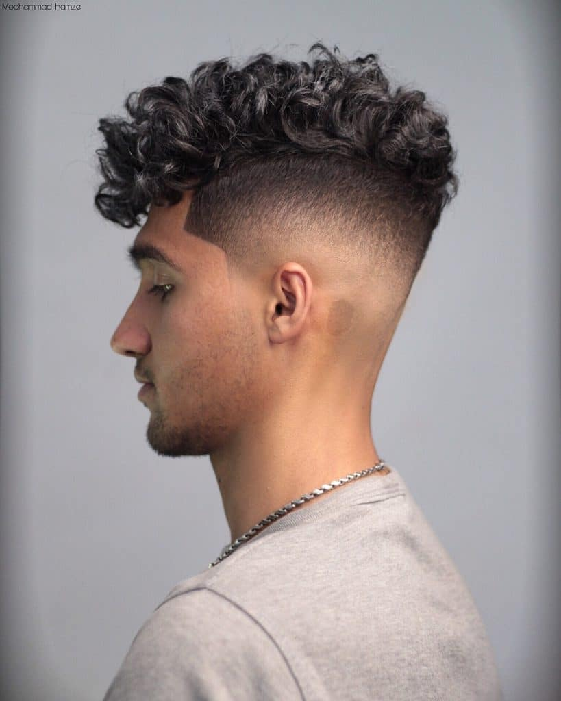medium curly hair haircut with shaved sides