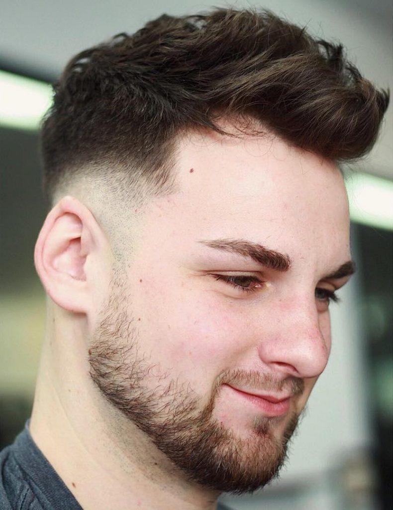 Longer top, short sides haircut for men
