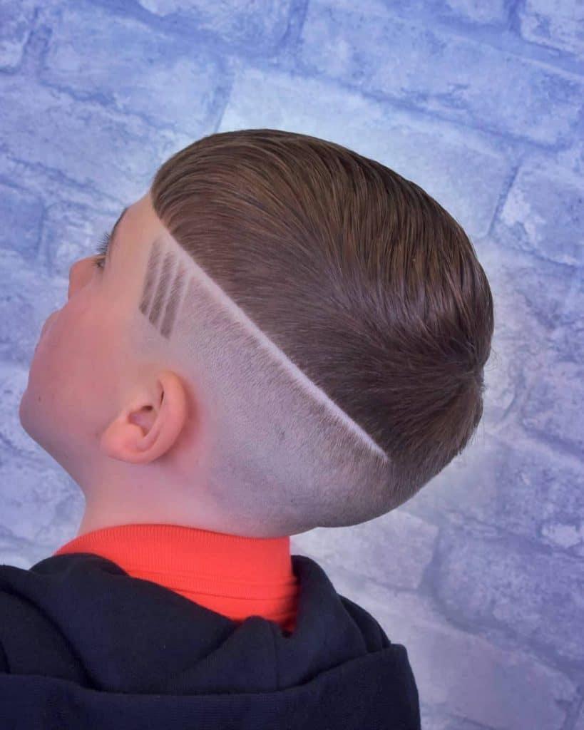 Bald fade haircut with line