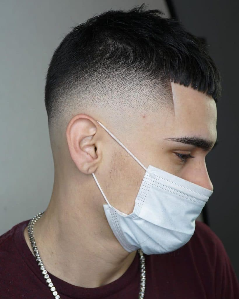 Crop top haircut with bald fade