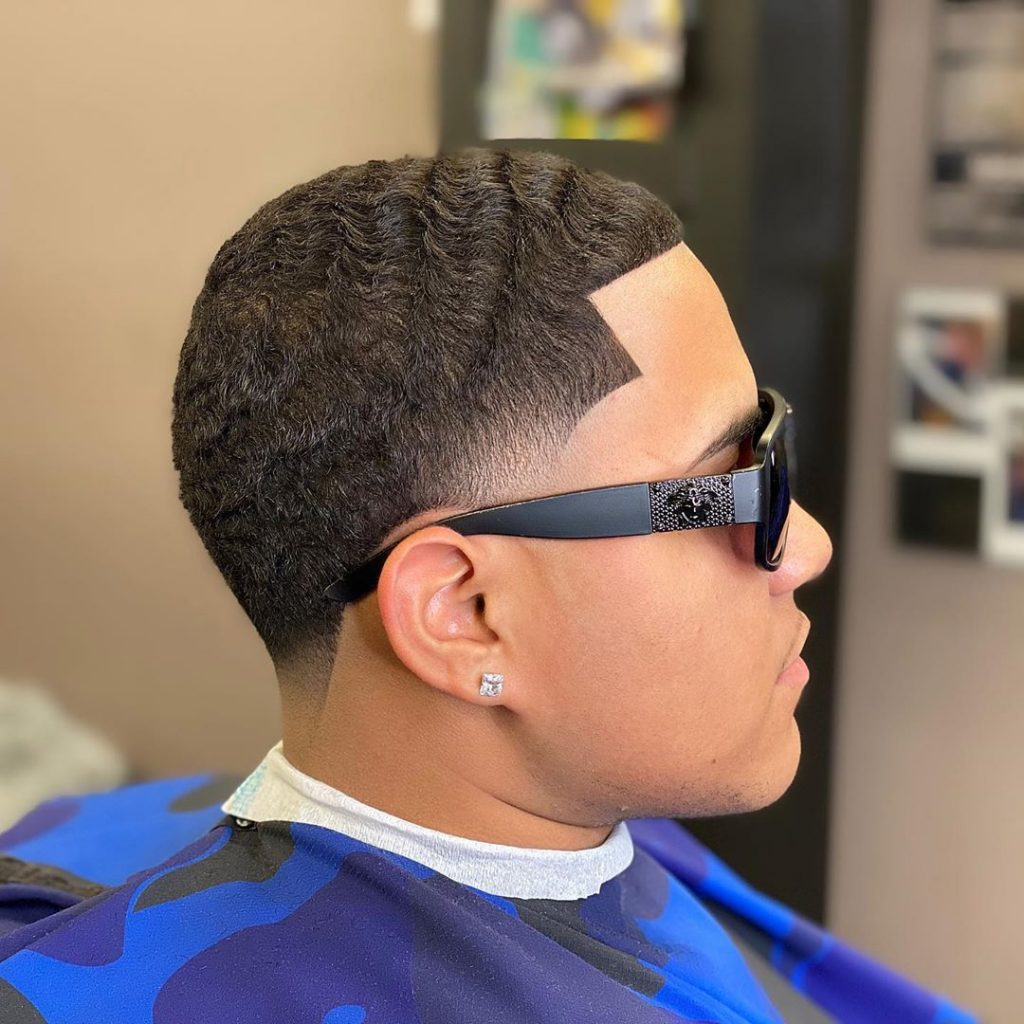 Low temple fade haircut black man