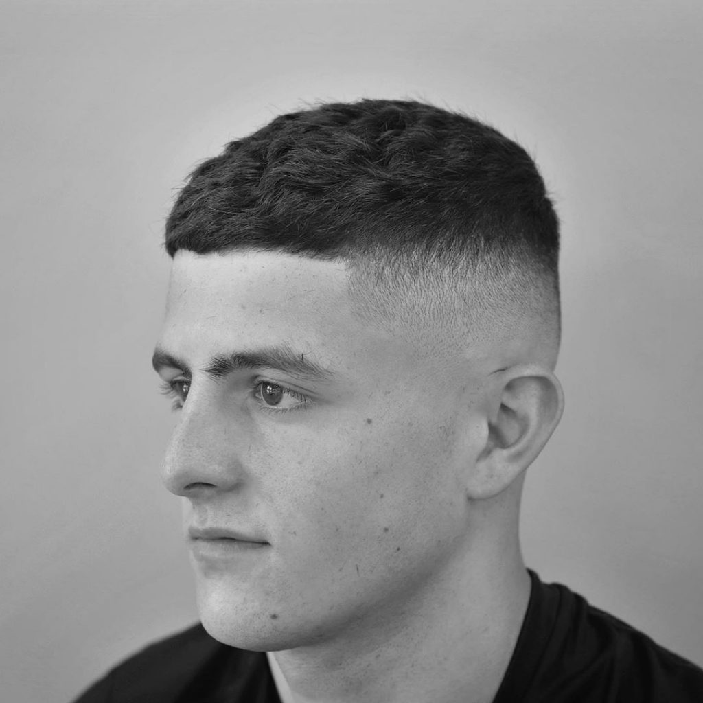 Short crop haircut with high fade