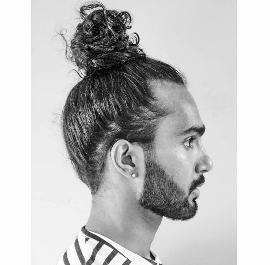 Bun hairstyle for men with long curly hair