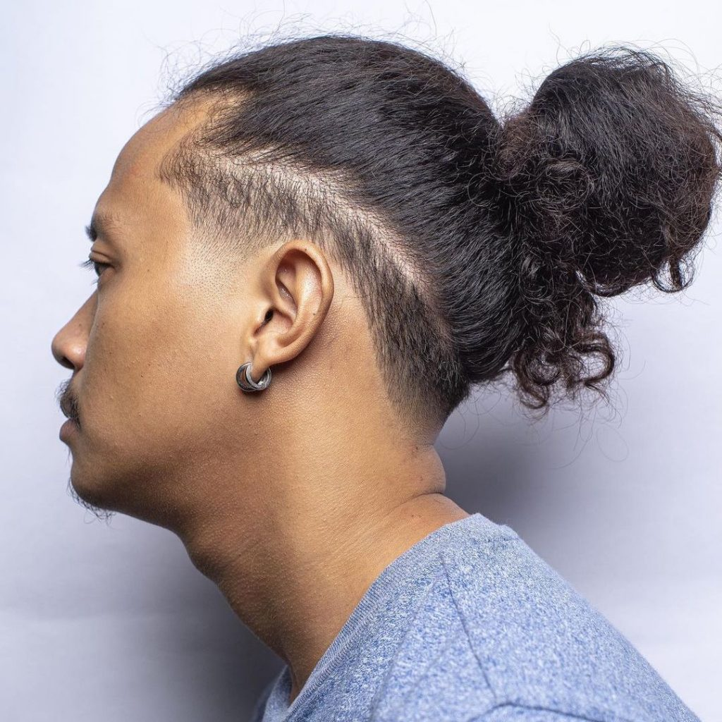 Man bun + low fade