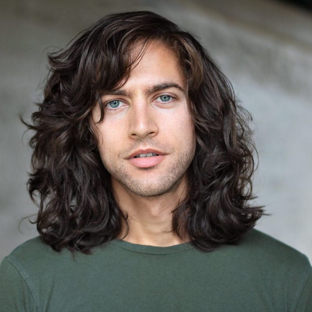 Long curly haircuts for men with bangs