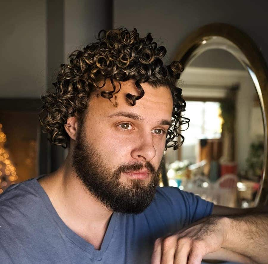 Medium length curly hair for men with beard