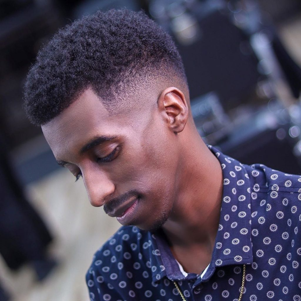 Drop fade haircut for Black men with curly hair