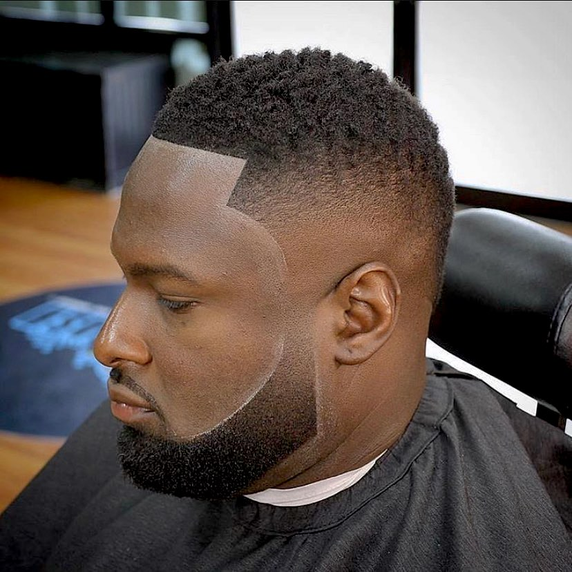 Faded haircut for Black men with thin beard