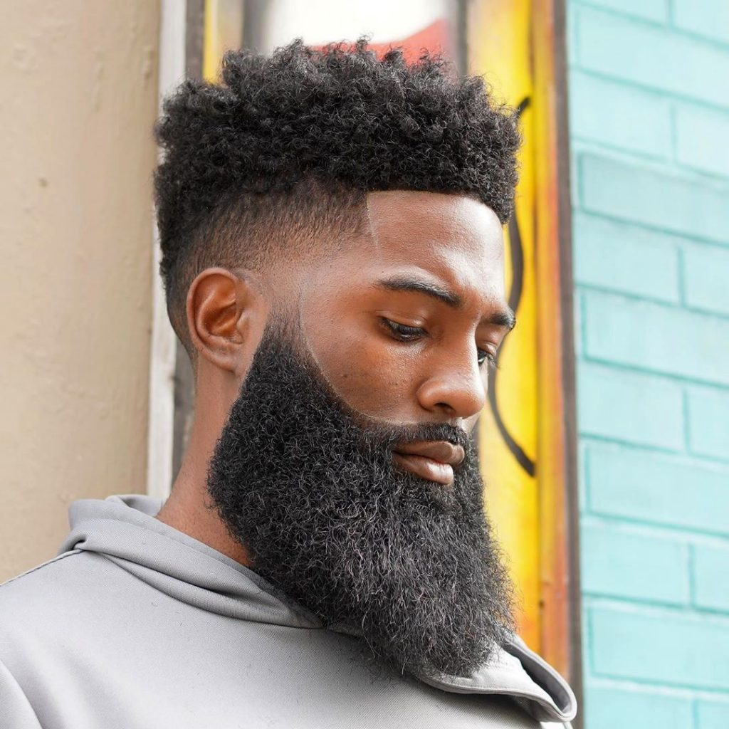 Faded haircut for Black men with full beard