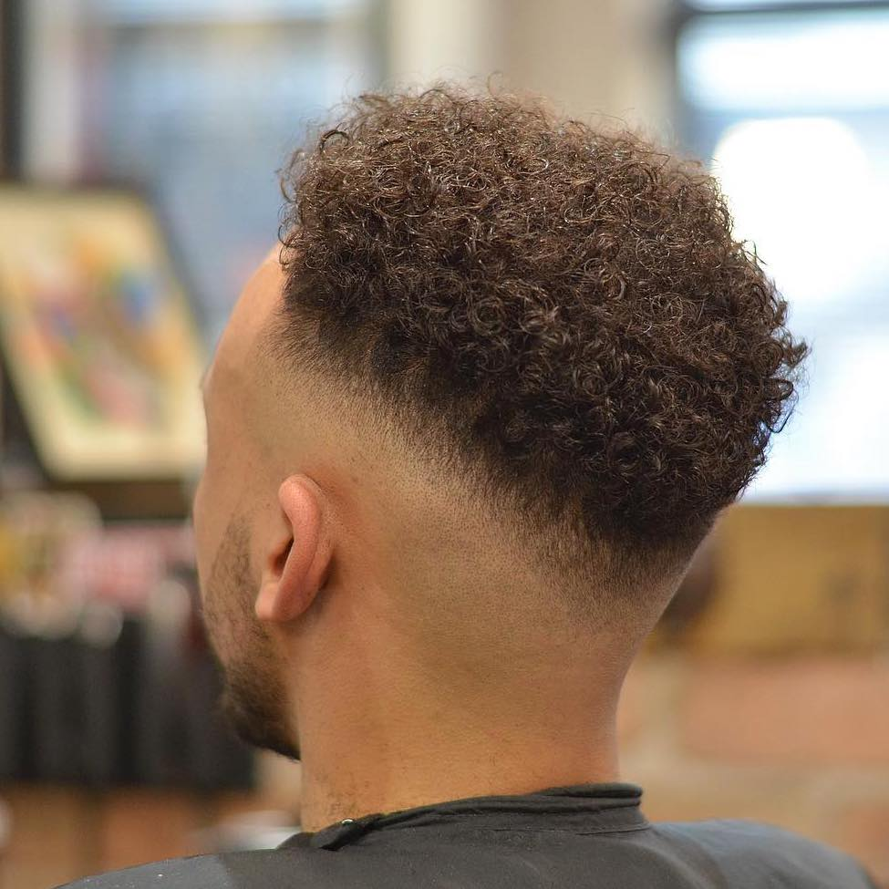 Mid fade haircut with curly hair Black men