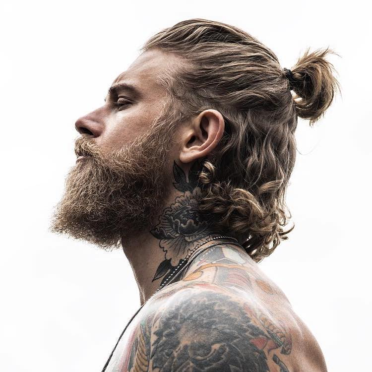 Half-up long hair hairstyle for men