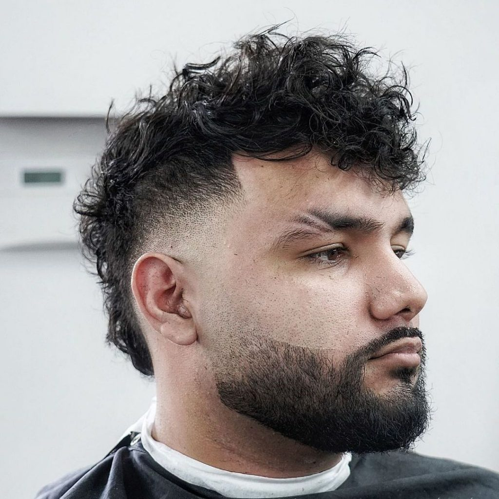 Mohawk with beard and brow slashes