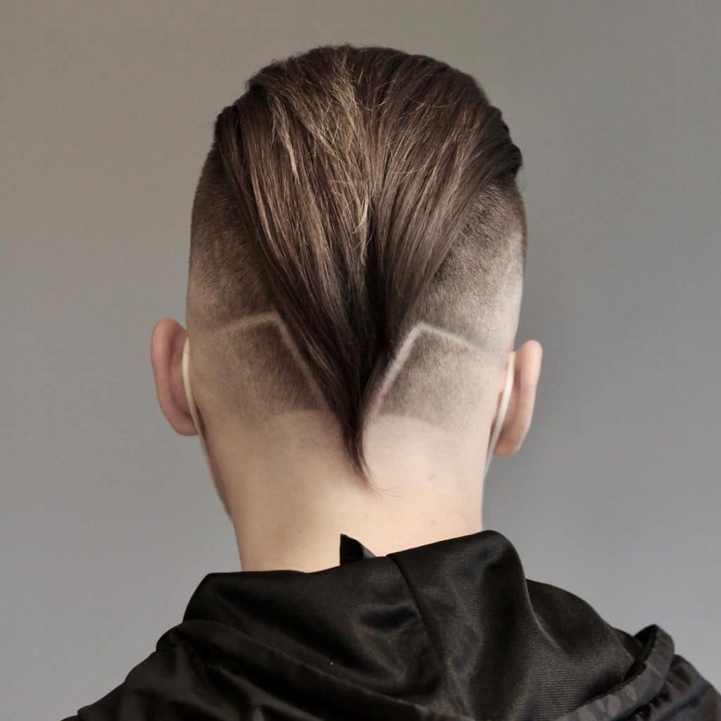 Slicked back undercut fade with designs