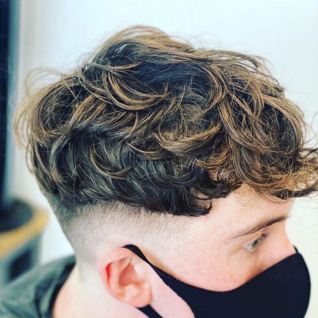 Hidden undercut fade for curly hair