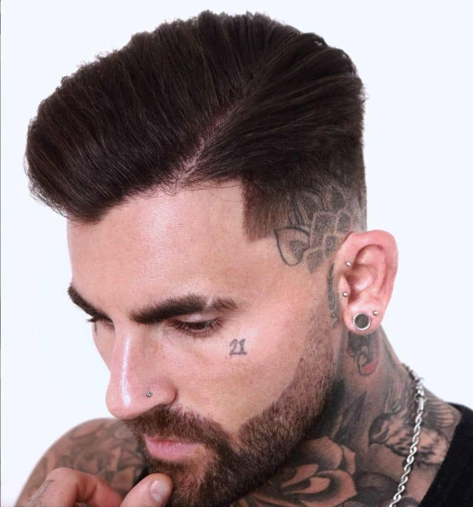 Fade haircut with part