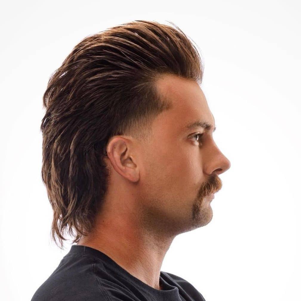 Medium length men's haircut mullet