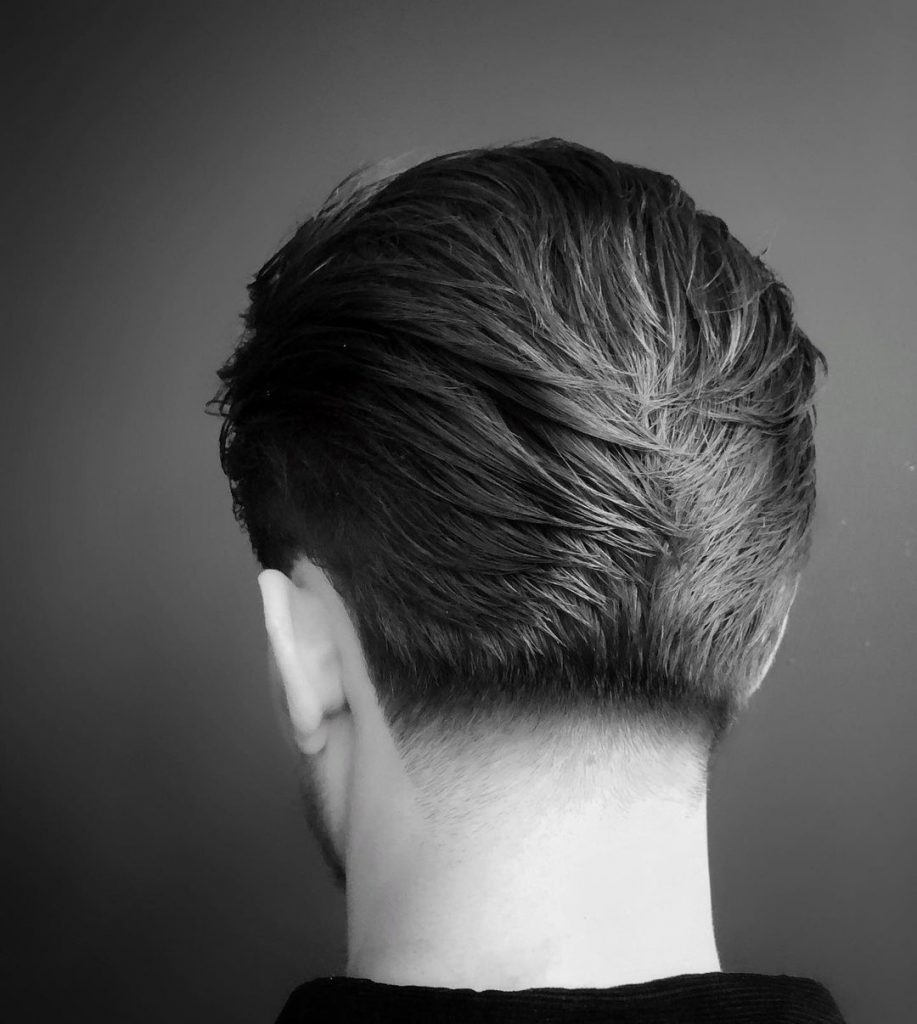 Medium length men's haircut slicked back