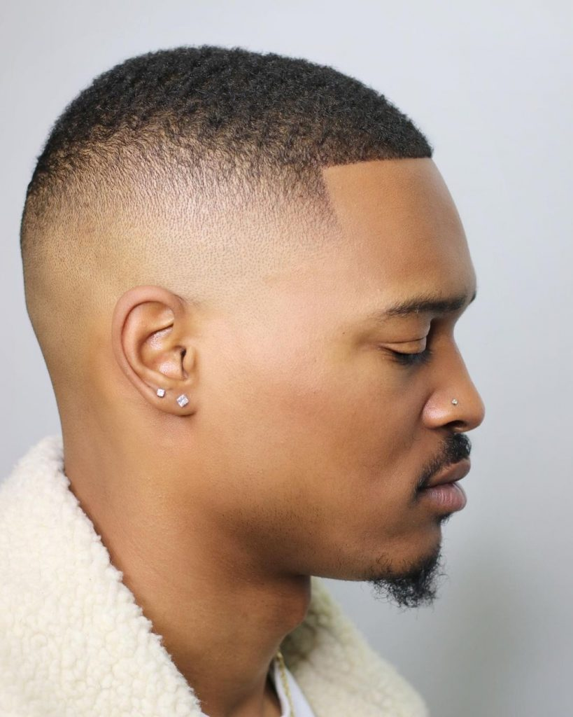 Men's high  fade haircut with waves