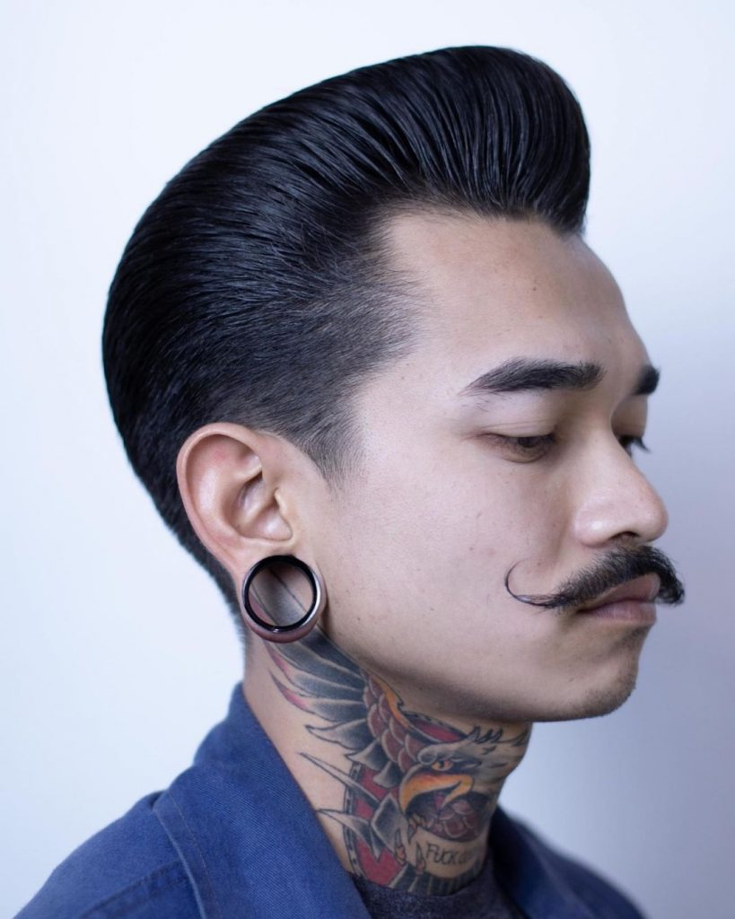 Greaser pompadour with handlebar mustache
