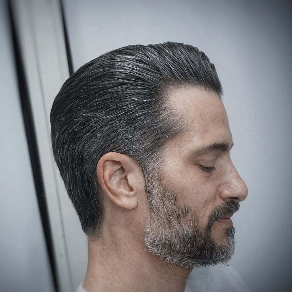 Slicked back hair for older men