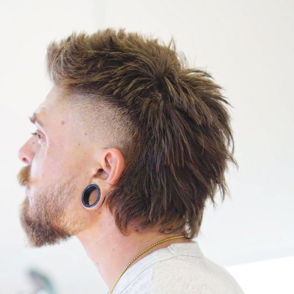 Mullet with temple fade for thick hair