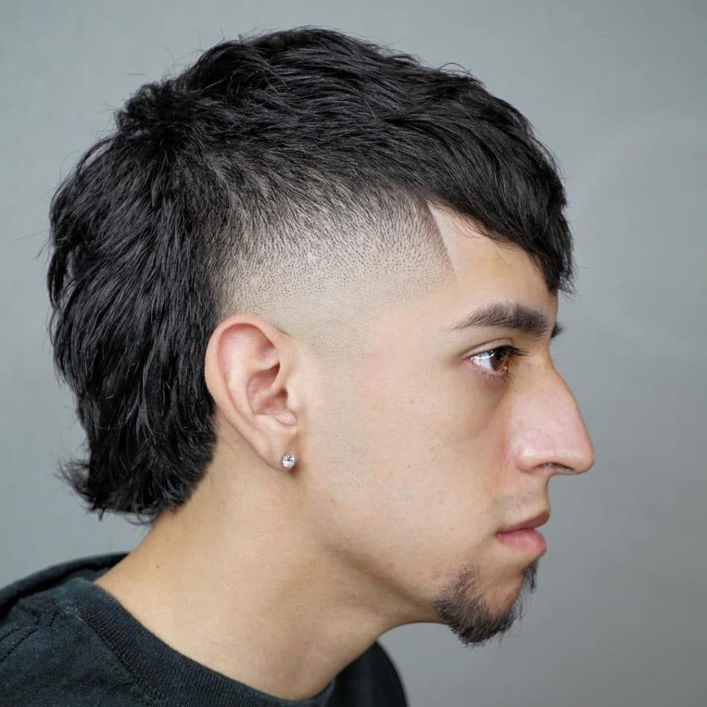 Short mullet haircut with fade